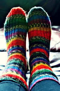 Feet wearing thick woolly socks